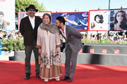 (L-R) Actor Habib Rezaei, director Rakhshan Bani-Etemad and actor Peyman Moaadi attend the 'Tales' (Ghesseha) premiere during the 71st Venice Film Festival on August 28, 2014 in Venice, Italy.