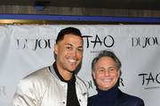 Professional baseball player Giancarlo Stanton (L) and Entrepreneur Jason Binn pose for a photo as they celebrate the DuJour Magazine Cover at TAO Downtown on March 26, 2019 in New York City.
