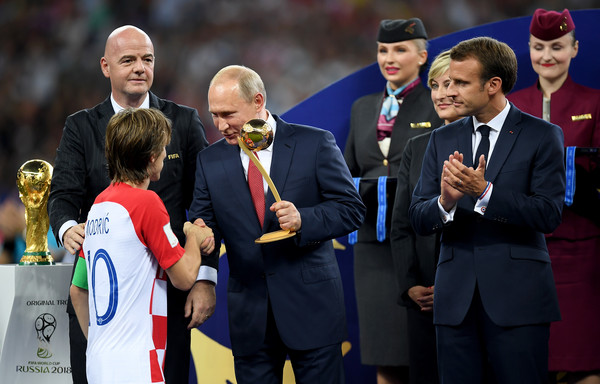 France v Croatia - 2018 FIFA World Cup Russia Final [event,championship,award,competition event,recreation,coach,competition,team,ceremony,valdimir putin,gianni infantino,emmanuel macron,russia,croatia,france,fifa,croatia - 2018 fifa world cup,final,2018 fifa world cup]