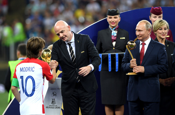 France v Croatia - 2018 FIFA World Cup Russia Final [event,championship,competition event,coach,manager,recreation,player,competition,official,sport venue,gianni infantino,valdimir putin,emmanuel macron,russia,croatia,france,fifa,croatia - 2018 fifa world cup,final,2018 fifa world cup]
