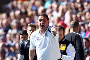 Manager Martin Allen of Gillingham gestures from the sideline during the npower League Two match between Gillingham and AFC Wimbledon at Priestfield Stadium on April 20, 2013 in Gillingham, England.