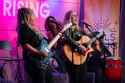 Cathy Henderson and Melissa Etheridge perform onstage during Girls Rising Panel & Performance at GRAMMY Museum on October 22, 2019 in Los Angeles, California.