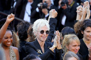 """Tonie Marshall (C) and filmmakers walks the red carpet in protest of the lack of female filmmakers honored throughout the history of the festival at the screening of """"Girls Of The Sun (Les Filles Du Soleil)"""" during the 71st annual Cannes Film Festival at the Palais des Festivals on May 12, 2018 in Cannes, France. Only 82 films in competition in the official selection have been directed by women since the inception of the Cannes Film Festival whereas 1,645 films in the past 71 years have been directed by men."""