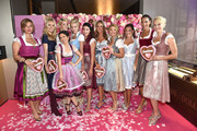 (L-R) Sarah Kronsbein, Vanessa Birkenstock, Viktoria Lauterbach, Julia Meise, Nina Meise, Alexandra Polzin-Leinauer, Maria Imizcoz, Viviane Geppart, Simone Ballack, Annabelle Mandeng and Natascha Gruen during the GlamWasen celebration in cooperation with Dresscoded at Armani Caffe at Fuenf Hoefe on September 1, 2017 in Munich, Germany.