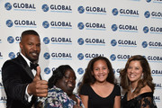 Jamie Foxx, DeOndra Dixon, Analise Foxx and Michelle Sie Whitten on the red carpet at the Global Down Syndrome 10th anniversary BBBY fashion show at Sheraton Denver Downtown Hotel on October 20, 2018 in Denver, Colorado.