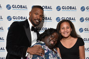 Jamie Foxx DeOndra Dixon and Analise Foxx on the red carpet at the Global Down Syndrome 10th anniversary BBBY fashion show at Sheraton Denver Downtown Hotel on October 20, 2018 in Denver, Colorado.