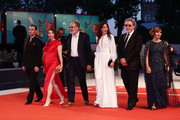 "Robinson Stevenin, Lola Naymark ,  Jean-Pierre Darroussin,  Anais Demoustier, Robert Guediguian and Ariane Ascaride walk the red carpet ahead of the ""Gloria Mundi"" screening during the 76th Venice Film Festival at Sala Grande on September 05, 2019 in Venice, Italy."