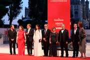 "Robinson Stevenin, Lola Naymark ,  Jean-Pierre Darroussin,  Anais Demoustier, Robert Guediguian, Ariane Ascaride,  Gerard Meylan  and Gregoire Leprince-Ringuet  walk the red carpet ahead of the ""Gloria Mundi"" screening during the 76th Venice Film Festival at Sala Grande on September 05, 2019 in Venice, Italy."