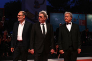"(L-R) Jean-Pierre Darroussin, Robert Guediguian and Gerard Meylan walk the red carpet ahead of the ""Gloria Mundi"" screening during the 76th Venice Film Festival at Sala Grande on September 05, 2019 in Venice, Italy."