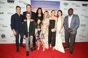 """(L-R) Andrew Walker, Andy Fraser, Ian Van Houten, Jordin Sparks, Makenzie Moss, Lindsay Pulsipher, Madeline Carroll and LaDainian Tomlinson attend the """"God Bless The Broken Road"""" Premiere at Silver Screen Theater at the Pacific Design Center on September 5, 2018 in West Hollywood, California."""