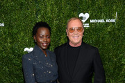 Lupita Nyong'o and Michael Kors attend God's Love We Deliver, Golden Heart Awards on October 21, 2019 in New York City.