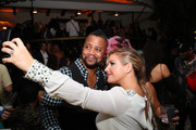 Cuba Gooding Jr. and guest take a selfie at What Goes Around Comes Around 25th Anniversary Celebration At The Versace Mansion With a Retrospective Tribute To Gianni Versace on December 08, 2018 in Miami Beach, Florida.