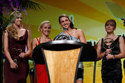 Rebecca Soni of the U.S. National Swim Team celebrates with teammates Jessica Hardy, Natalie Coughlin and Dana Vollmer after winning Relay Performance of the Year award during the 7th Annual Golden Goggle Awards at the Marriott Marquis on November 22, 2010 in New York City.
