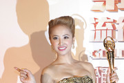 Taiwanese singer Jolin Tsai holds her award for the Best Song of the Year at the 24th Golden Melody Awards on July 6, 2013 in Taipei, Taiwan.