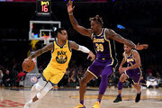 D'Angelo Russell #0 of the Golden State Warriors drives to the basket on Dwight Howard #39 of the Los Angeles Lakers during the first half at Staples Center on November 13, 2019 in Los Angeles, California.  NOTE TO USER: User expressly acknowledges and agrees that, by downloading and/or using this photograph, user is consenting to the terms and conditions of the Getty Images License Agreement.