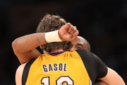Pau Gasol #16 and Kobe Bryant #24 of  the Los Angeles Lakers emnbrace after a Gasol basket in the fourth quarter gainst the Golden State Warriors the Los Angeles Lakers at Staples Center on January 6, 2012 in Los Angeles, California.  The Lakers won 97-90. NOTE TO USER: User expressly acknowledges and agrees that, by downloading and or using this photograph, User is consenting to the terms and conditions of the Getty Images License Agreement.