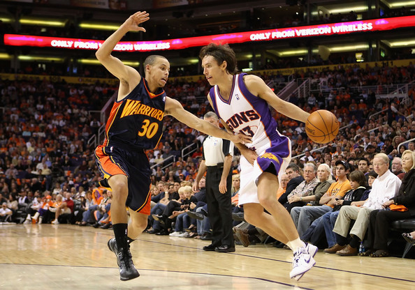 Steve Nash #13 of the Phoenix Suns handles the ball under pressure from Stephen Curry #30 of the Golden State Warriors during the NBA game at US Airways Center on October 30, 2009 in Phoenix, Arizona. NOTE TO USER: User expressly acknowledges and agrees that, by downloading and or using this photograph, User is consenting to the terms and conditions of the Getty Images License Agreement.