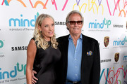 Margaret Devogelaere (L) and Peter Fonda attend Goldie's Love In For Kids at Ron Burkle's Green Acres Estate on November 3, 2017 in Beverly Hills, California.