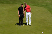 James Wright and Richard Challoner of Swindon Golf Club line up a putt on the 18th green during the Golfbreaks.com PGA Fourball Championship - Midland Qualifier on June 10, 2015 in Wolverhampton, England.
