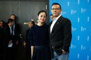 Actress Zhou Yun and director Jiang Wen attend the 'Gone with the Bullets' (Yi bu zhi yao) photocall during the 65th Berlinale International Film Festival at Grand Hyatt Hotel on February 11, 2015 in Berlin, Germany.