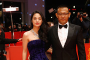 Actress Zhou Yun and director Jiang Wen attend the 'Gone with the Bullets' (Yi bu zhi yao)premiere during the 65th Berlinale International Film Festival at Berlinale Palace on February 11, 2015 in Berlin, Germany.