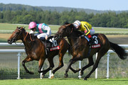 Kieran Shoemark and Vividly (16) beat Frankie Dettori and Craylands to the line in the Markel Insurance British EBF Maiden Fillies' Stakes at Goodwood on August 01, 2019 in Chichester, England.
