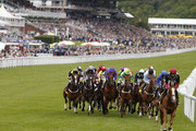 William Twiston-Davies riding Sands Of Fortune (R, red cap) lead all the way to win The Victoria Racing Club Goodwood Stakes at Goodwood racecourse on July 29, 2015 in Chichester, England.