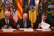 (L-R) Winfried Kretschmann, Minister-President of the German state of Baden-Wurttemberg, California Gov Jerry Brown and Baja California Governor Francisco A. Vega de Lamadrid sign a climate change bill during a bill signing event at the Leland Stanford Mansion on May 19, 2015 in Sacramento, California.  Gov. Brown signed a first-of-its-kind agreement with leaders from 11 states and international provinces to limit the increase in global average temperature to below 2 degrees Celsius.