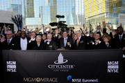 (2L-R) MGM Mirage board members Willie Davis and Mel Wolzinger, MGM Mirage CFO Dan D'Arrigo, MGM Mirage Chairman and CEO Jim Murren and President and COO of Infinity World Development Bill Grounds ring the bell to close the trading day on the New York Stock Exchange during the grand opening for the Aria Resort & Casino at CityCenter December 16, 2009 in Las Vegas, Nevada. The 67-acre, USD 8.5 billion mixed-use urban development center, a joint project between MGM Mirage and Dubai World, is said to be the biggest privately financed construction project in United States history and one of the world's largest green projects being built with the Leadership in Energy & Environmental Design (LEED) Gold certified Green Building Rating System. Aria is CityCenter's centerpiece and includes a 150,000-square-foot casino and 4,004 hotel rooms and suites.