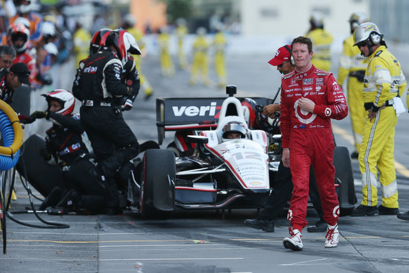 Scott Dixon of New Zealand, driver of the #9 Target Chip Ganassi Racing Honda Dallara, walks away from Will Power of Australia, driver of the #12 Team Penske Chevrolet Dallara, after being knocked out of  the IZOD IndyCar Series Baltimore Grand Prix on September 1, 2013 in Baltimore, Maryland.