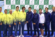 (From L-R) Sam Groth, Lleyton Hewitt, Captain Wally Masur, Bernard Tomic and Thanasi Kokkinakis of Australia pose for a photo with the Great Britain team of (from L-R) Jamie Murray, Dan Evans, Captain Leon Smith, Andy Murray and Dominic Inglot after the draw during a practice session at Emirates Arena on September 17, 2015 in Glasgow, Scotland.