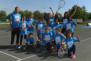 Former British No.1 Greg Rusedski, TV Presenter Gabby Logan and Former British No. 1 Tennis player Annabel Croft pose for pictures with kids from Heathbrook Primary School as they launch the Great British Tennis Weekend at Clapham Common on May 13, 2015 in London, England.