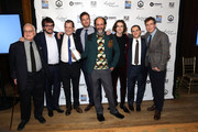 """Director Luca Guadagnino poses with the cast of """"Call Me By Yout Name"""" with their award for Best Feature Film at the 2017 Gotham Awards sponsored by Greater Ft. Lauderdale Tourism at Cipriani, Wall Street on November 27, 2017 in New York City."""