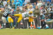Randall Cobb #18 of the Green Bay Packers dives for an overthrown pass as Bene' Benwikere #25 and Charles Tillman #31 of the Carolina Panthers defend during their game at Bank of America Stadium on November 8, 2015 in Charlotte, North Carolina. The Panthers won 37-29.