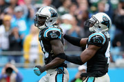 Charles Tillman #31 and  Roman Harper #41 of the Carolina Panthers react after a play against the Green Bay Packers in the 1st half during their game at Bank of America Stadium on November 8, 2015 in Charlotte, North Carolina.