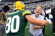Jimmy Graham #80 of the Green Bay Packers goes to hug Ellen DeGeneres before the game against the Dallas Cowboys at AT&T Stadium on October 06, 2019 in Arlington, Texas.