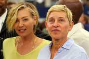 Portia de Rossi and Ellen DeGeneres watch the Green Bay Packers and Dallas Cowboys warm up before the game at AT&T Stadium on October 06, 2019 in Arlington, Texas.