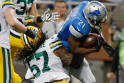 Reggie Bush #21 of the Detroit Lions tries to avoid the tackle by Jamari Lattimore #57 of the Green Bay Packers in the fourth quarter at Ford Field on September 21, 2014 in Detroit, Michigan the lions win 19-7.