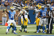 Reggie Bush #21 of the Detroit Lions signals first down during the fourth quarter of the game against the Green Bay Packers at Ford Field on September 21, 2014 in Detroit, Michigan. The Lions defeated the Packers 19-7.