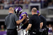 Running back Adrian Peterson #28 of the Minnesota Vikings is helped off the field after an injury during the game against the Green Bay Packers on September 18, 2016 in Minneapolis, Minnesota.