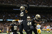 Jimmy Graham #80 of the New Orleans Saints catches a pass for a touchdown as Tramon Williams #38 of the Green Bay Packers tries to defend during the second half at Mercedes-Benz Superdome on October 26, 2014 in New Orleans, Louisiana.