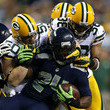 A.J. Hawk and Marshawn Lynch Photos