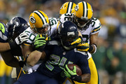 A.J. Hawk and Marshawn Lynch Photos Photo