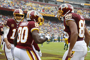 Jamison Crowder #80 of the Washington Redskins celebrates with Alex Smith #11 and Jordan Reed #86 after a touchdown in the second quarter against the Green Bay Packers at FedExField on September 23, 2018 in Landover, Maryland.
