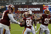 Jamison Crowder #80 of the Washington Redskins celebrates with Jeremy Sprinkle #87 after a touchdown in the second quarter against the Green Bay Packers at FedExField on September 23, 2018 in Landover, Maryland.