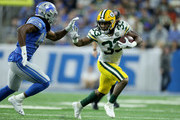 Aaron Jones #33 of the Green Bay Packers runs against Jalen Reeves-Maybin #44 of the Detroit Lions during the second half at Ford Field on October 7, 2018 in Detroit, Michigan.