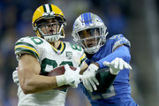 Jimmy Graham #80 of the Green Bay Packers makes a catch against DeShawn Shead #26 of the Detroit Lions during the first half at Ford Field on October 7, 2018 in Detroit, Michigan.