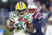 Marquez Valdes-Scantling #83 of the Green Bay Packers makes a reception against Jason McCourty #30 of the New England Patriots during the second half at Gillette Stadium on November 4, 2018 in Foxborough, Massachusetts.
