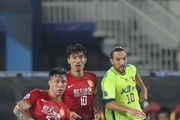 Dejan Damjanovic (R) of FC Seoul competes for the ball with Zhang linpeng (L) and Zheng Zhi of Guangzhou Evergrande during the AFC Champions League Final 2nd leg between Guangzhou Evergrande and FC Seoul at Tianhe Stadium on November 9, 2013 in Guangzhou, China.