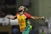 In this handout image provided by CPL T20, Imran Tahir of Guyana Amazon Warriors celebrates the dismissal of Johnson Charles of Jamaica Tallawahs during match 29 of the Hero Caribbean Premier League match between Guyana Amazon Warriors and Jamaica Tallawahs at Guyana National Stadium on September 8, 2018 in Providence, Guyana.